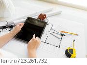 Купить «close up of hand with blueprint and tablet pc», фото № 23261732, снято 16 февраля 2016 г. (c) Syda Productions / Фотобанк Лори
