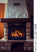 Купить «close up of burning fireplace at home», фото № 23261844, снято 16 октября 2015 г. (c) Syda Productions / Фотобанк Лори