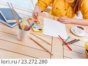 Купить «Young school gilr drawing pictures at home», фото № 23272280, снято 24 июня 2016 г. (c) Elnur / Фотобанк Лори