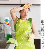 Купить «Unhappy girl do housework», фото № 23282248, снято 19 октября 2018 г. (c) Яков Филимонов / Фотобанк Лори
