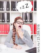 Купить «Женщина зевает на рабочем месте», фото № 23288516, снято 29 июня 2016 г. (c) Darkbird77 / Фотобанк Лори