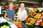 Woman choosing seasonal fruits, фото № 23299768, снято 24 июля 2016 г. (c) Яков Филимонов / Фотобанк Лори