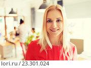 Купить «happy creative woman at office or bureau», фото № 23301024, снято 29 марта 2015 г. (c) Syda Productions / Фотобанк Лори