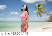 happy young woman in pink bikini swimsuit. Стоковое фото, фотограф Syda Productions / Фотобанк Лори