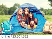 Купить «happy friends with backpacks in tent at camping», фото № 23301332, снято 25 июля 2015 г. (c) Syda Productions / Фотобанк Лори