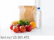 Купить «close up of paper bag with vegetables and water», фото № 23301472, снято 3 июня 2016 г. (c) Syda Productions / Фотобанк Лори