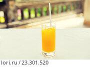 Купить «glass of fresh orange fruit juice at restaurant», фото № 23301520, снято 21 февраля 2015 г. (c) Syda Productions / Фотобанк Лори