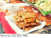 Купить «spring rolls and snacks at street market», фото № 23301780, снято 7 февраля 2015 г. (c) Syda Productions / Фотобанк Лори