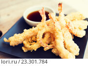 Купить «close up of deep-fried shrimps and soy sauce», фото № 23301784, снято 15 февраля 2015 г. (c) Syda Productions / Фотобанк Лори