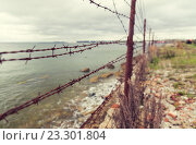 Купить «barb wire fence over gray sky and sea», фото № 23301804, снято 30 сентября 2015 г. (c) Syda Productions / Фотобанк Лори