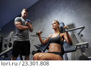 Купить «man and woman flexing muscles on gym machine», фото № 23301808, снято 19 апреля 2015 г. (c) Syda Productions / Фотобанк Лори