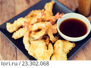 Купить «close up of deep-fried shrimps and soy sauce», фото № 23302068, снято 15 февраля 2015 г. (c) Syda Productions / Фотобанк Лори