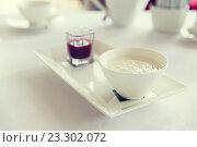 Купить «close up of yogurt and jam at restaurant», фото № 23302072, снято 24 февраля 2015 г. (c) Syda Productions / Фотобанк Лори