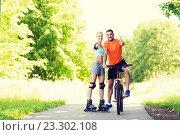 Купить «couple on rollerblades and bike showing thumbs up», фото № 23302108, снято 5 июля 2015 г. (c) Syda Productions / Фотобанк Лори