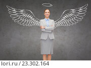 Купить «happy businesswoman with angel wings and nimbus», фото № 23302164, снято 14 февраля 2014 г. (c) Syda Productions / Фотобанк Лори
