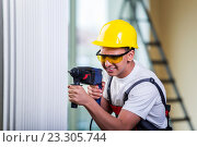Купить «Man drilling the wall with drill perforator», фото № 23305744, снято 2 мая 2016 г. (c) Elnur / Фотобанк Лори