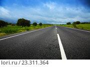 Купить «landscpae with road and heavy clouds», фото № 23311364, снято 12 мая 2016 г. (c) Яков Филимонов / Фотобанк Лори