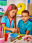 Children girl and boy with brush painting in primary school., фото № 23314484, снято 4 октября 2015 г. (c) Gennadiy Poznyakov / Фотобанк Лори