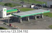 Купить «Автозаправка British Petroleum на Пятницком шоссе в Митино солнечным утром. Таймлапс», эксклюзивный видеоролик № 23334192, снято 25 июня 2019 г. (c) Виктор Тараканов / Фотобанк Лори