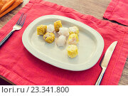 Купить «plate of spring rolls with rice on table», фото № 23341800, снято 14 февраля 2015 г. (c) Syda Productions / Фотобанк Лори
