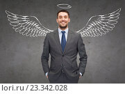 Купить «smiling businessman with angel wings and nimbus», фото № 23342028, снято 14 февраля 2014 г. (c) Syda Productions / Фотобанк Лори