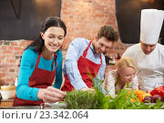 Купить «happy friends and male chef cooking in kitchen», фото № 23342064, снято 12 февраля 2015 г. (c) Syda Productions / Фотобанк Лори