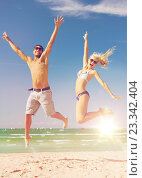 Купить «couple jumping on the beach», фото № 23342404, снято 4 августа 2012 г. (c) Syda Productions / Фотобанк Лори