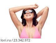 Купить «happy woman in sunglasses and swimsuit», фото № 23342972, снято 14 апреля 2015 г. (c) Syda Productions / Фотобанк Лори