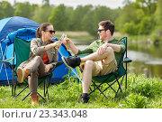 Купить «happy couple clinking drinks at campsite tent», фото № 23343048, снято 27 мая 2016 г. (c) Syda Productions / Фотобанк Лори