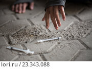 Купить «close up of addict woman hands and drug syringes», фото № 23343088, снято 9 июня 2016 г. (c) Syda Productions / Фотобанк Лори