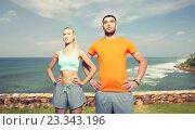 Купить «happy couple exercising over sea or beach», фото № 23343196, снято 5 июля 2015 г. (c) Syda Productions / Фотобанк Лори