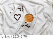 Купить «Чашка кофе и кофейные зёрна на белой шелковой ткани», фото № 23345704, снято 31 января 2016 г. (c) Marina Sharova / Фотобанк Лори