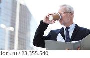 Купить «senior businessman with coffee and folder in city», видеоролик № 23355540, снято 23 июля 2016 г. (c) Syda Productions / Фотобанк Лори