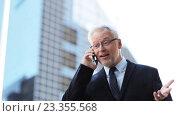 Купить «senior businessman calling on smartphone in city», видеоролик № 23355568, снято 25 июля 2016 г. (c) Syda Productions / Фотобанк Лори