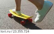 Купить «teenage girl feet riding short modern skateboard», видеоролик № 23355724, снято 1 августа 2016 г. (c) Syda Productions / Фотобанк Лори