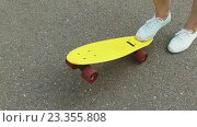 Купить «teenage girl toot putting short skateboard on end», видеоролик № 23355808, снято 1 августа 2016 г. (c) Syda Productions / Фотобанк Лори