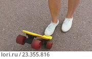 Купить «teenage girl toot putting short skateboard on end», видеоролик № 23355816, снято 1 августа 2016 г. (c) Syda Productions / Фотобанк Лори