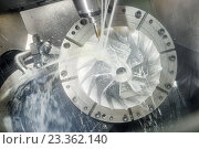 Купить «Milling metalworking process. Industrial CNC metal machining by vertical mill», фото № 23362140, снято 26 мая 2015 г. (c) Дмитрий Калиновский / Фотобанк Лори
