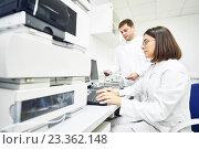 Купить «Researchers analyzing liquid chromatography data», фото № 23362148, снято 17 сентября 2015 г. (c) Дмитрий Калиновский / Фотобанк Лори