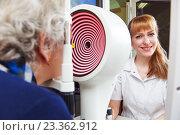 Купить «ophthalmology. senior woman patient under sight testing in clinic», фото № 23362912, снято 5 марта 2015 г. (c) Дмитрий Калиновский / Фотобанк Лори
