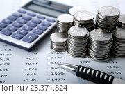 Купить «Стопки российских рублей с калькулятором», фото № 23371824, снято 3 августа 2016 г. (c) Александр Калугин / Фотобанк Лори