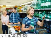 Купить «Female customers purchasing water in hypermarket», фото № 23378636, снято 17 ноября 2019 г. (c) Яков Филимонов / Фотобанк Лори