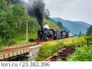 Купить «Работающий паровоз на Кругобайкальской железной дороге», фото № 23382396, снято 28 июля 2016 г. (c) Виктор Никитин / Фотобанк Лори
