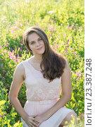 Купить «Portrait of girl of 16 years in flower meadow», фото № 23387248, снято 13 июля 2016 г. (c) Володина Ольга / Фотобанк Лори