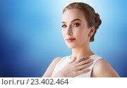 Купить «smiling woman in white dress with diamond jewelry», фото № 23402464, снято 14 апреля 2016 г. (c) Syda Productions / Фотобанк Лори