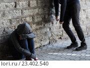 close up of addicts on street. Стоковое фото, фотограф Syda Productions / Фотобанк Лори