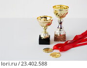 Купить «close up of sports golden cups and medals», фото № 23402588, снято 17 июня 2016 г. (c) Syda Productions / Фотобанк Лори
