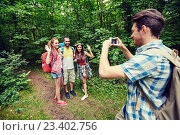 friends with backpack taking selfie by smartphone. Стоковое фото, фотограф Syda Productions / Фотобанк Лори