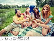 Купить «happy friends with tent and drinks at campsite», фото № 23402764, снято 25 июля 2015 г. (c) Syda Productions / Фотобанк Лори