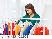 Купить «happy woman choosing clothes at home wardrobe», фото № 23402964, снято 19 февраля 2016 г. (c) Syda Productions / Фотобанк Лори